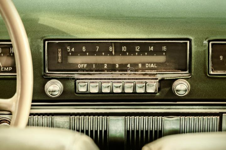 retro-styled-image-old-car-radio-inside-green-classic-52458889